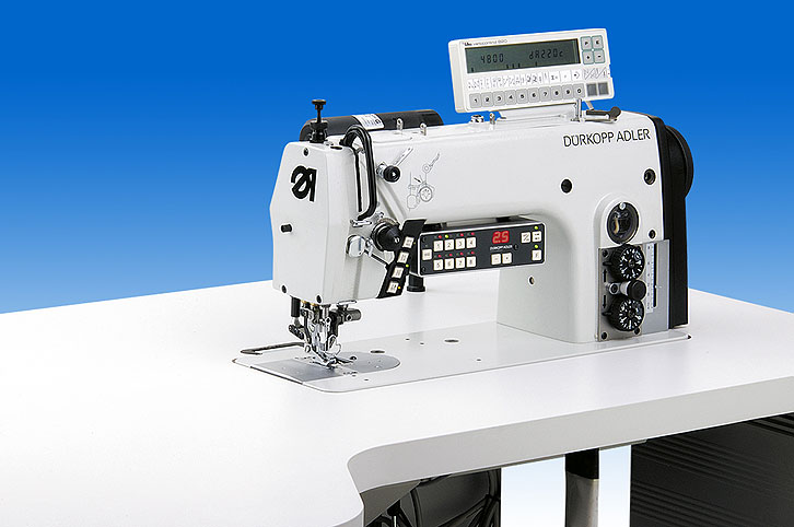 Lockstitch machine with top feet and separately driven edge trimmer