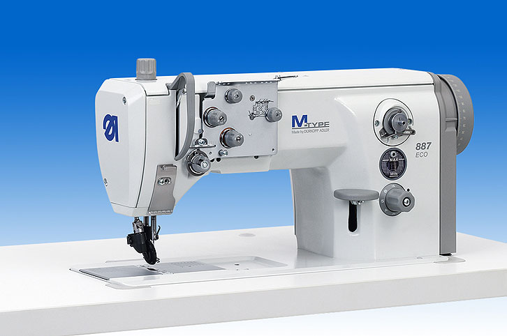 Single needle lockstitch flat bed machine with wheel feed