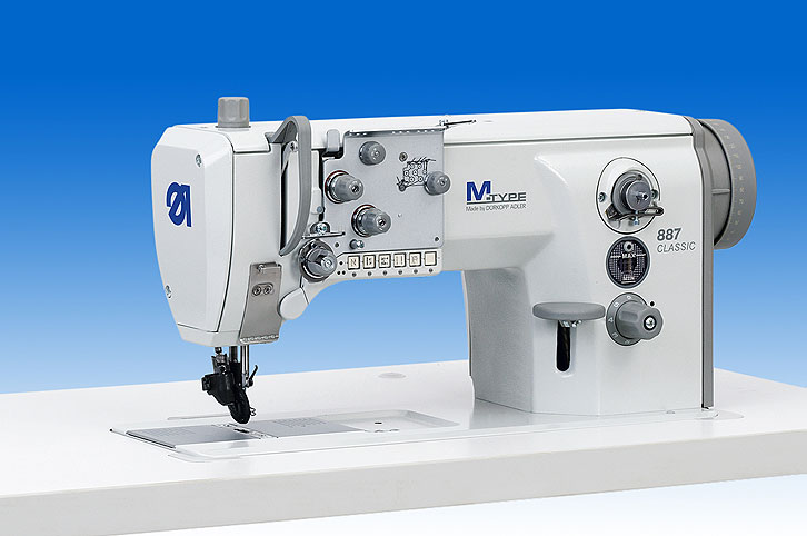 Single needle lockstitch flatbed machine with DA Direct Drive, wheel feed
